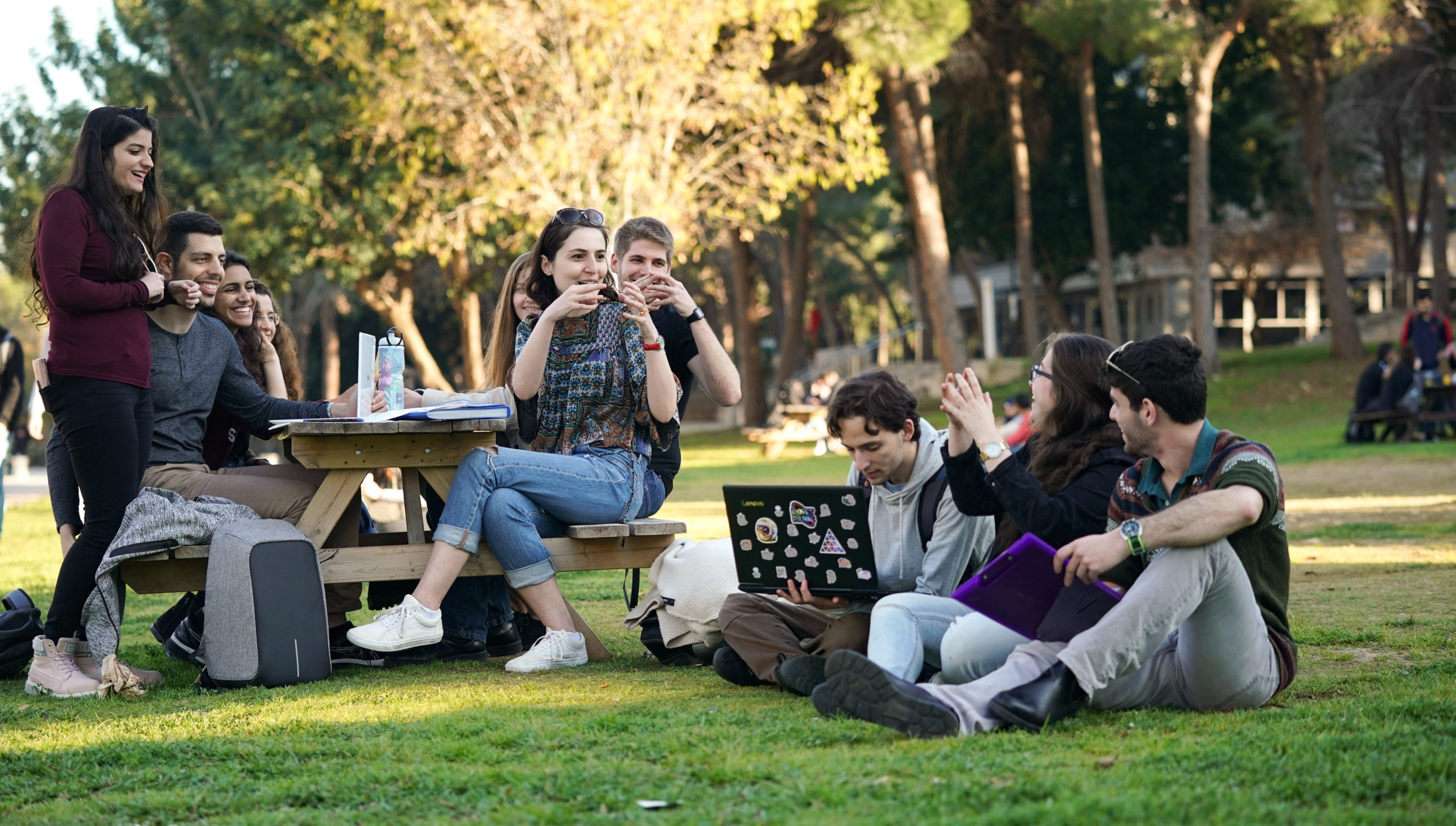 Math students talking on the lawn near the Technion's math faculty